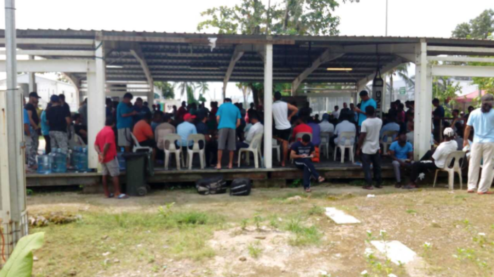 Refugees and asylum seekers on Manus Island are pictured in a silent, peaceful protest on Tuesday
