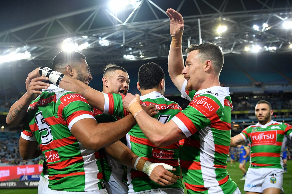 Robert Jennings (left) celebrates with Rabbitohs teammates after scoring a try during the Round 26 match against Parramatta Eels on Friday