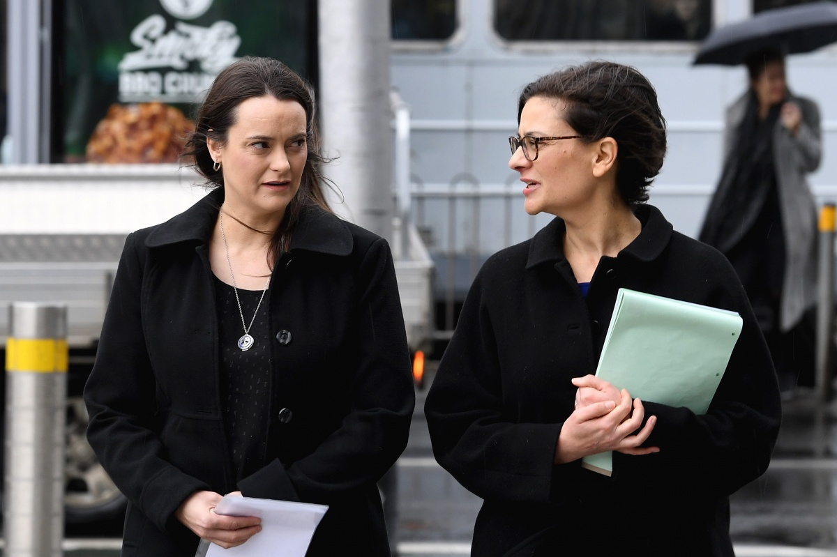 Jennifer Kanis, Maurice Blackburn's head of social justice (right), walk to the Federal court in Melbourne