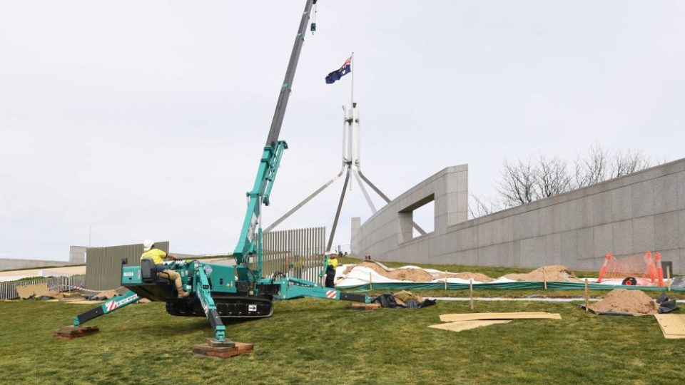 A security fence goes up around Parliament House