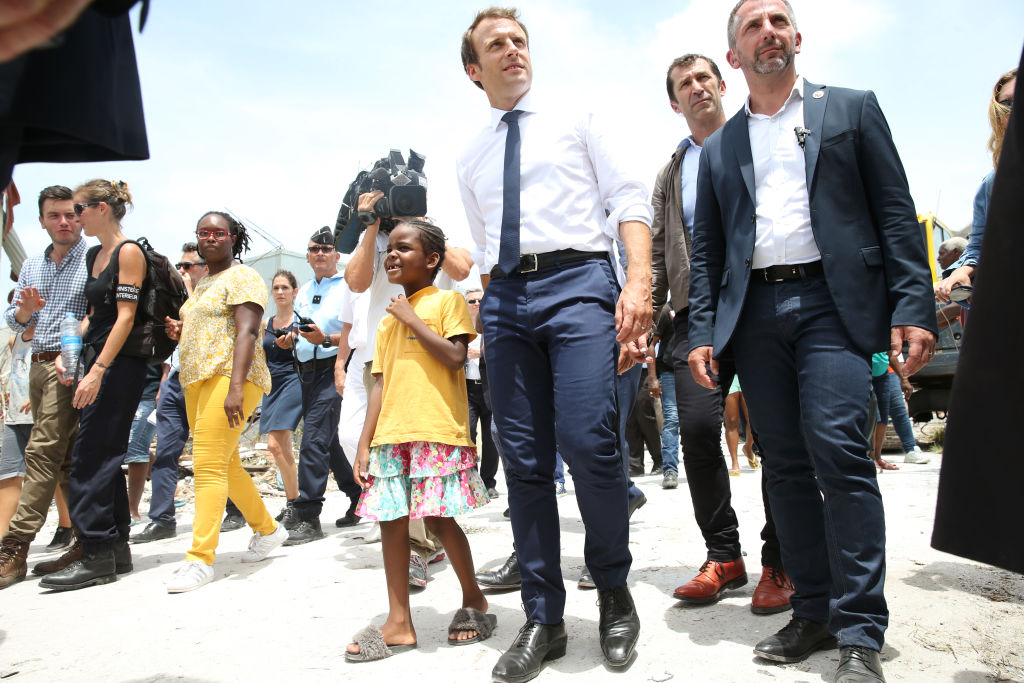 Mr Macron is pictured visiting St Martin on Tuesday after Hurricane Irma's destruction.