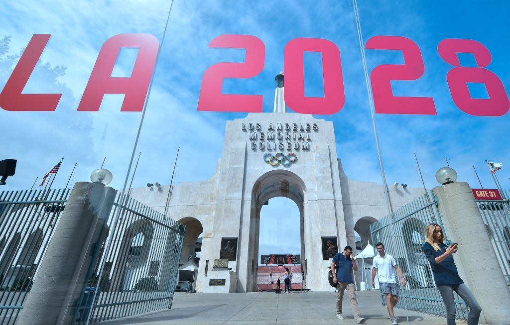 Former US Olympic gymnast Nastia Liukin (R) checks her cellphone at the Los Angeles Coliseum on September 13, 2017 in Los Angeles, California, as the city was officially named as host of the 2028 Summer Olympics by a unanimous vote of the International Olympic Committee in Lima, Peru