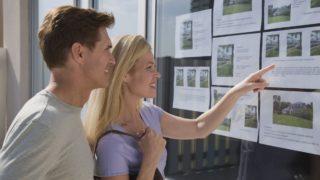real estate window couple