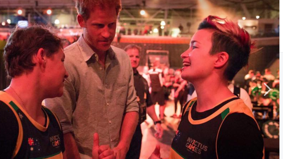 Michaela Gilewicz (R) meets Prince Harry
