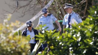 Police are pictured at the scene after a woman, 50, was found dead at an Avalon home.