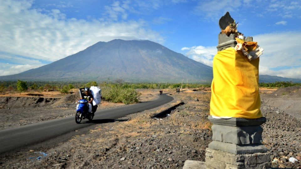 Mount Agung behind Balinese Hindu temples seen from Karangasem on resort island of Bali.