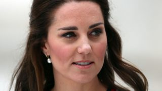 Kate Middleton carrying an umbrella