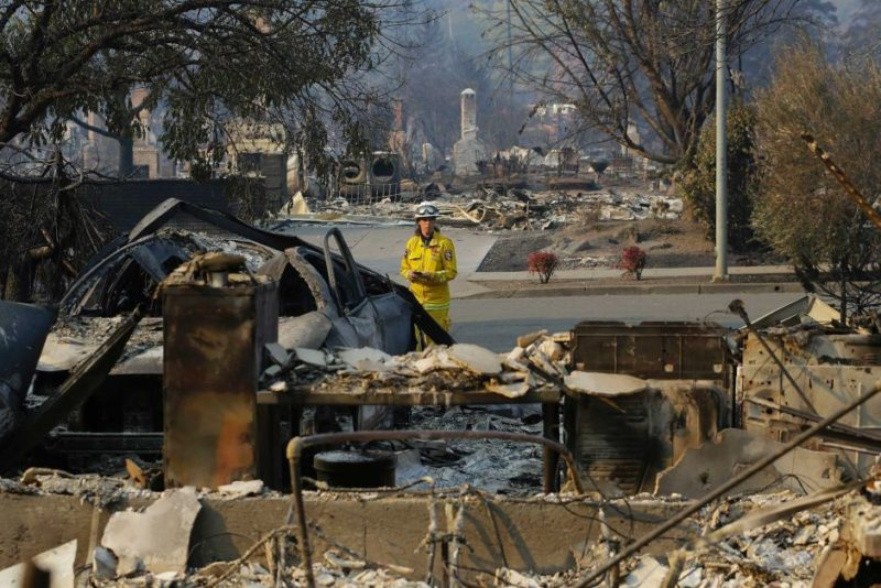 A California firefighter surveys the damage in Santa Rosa