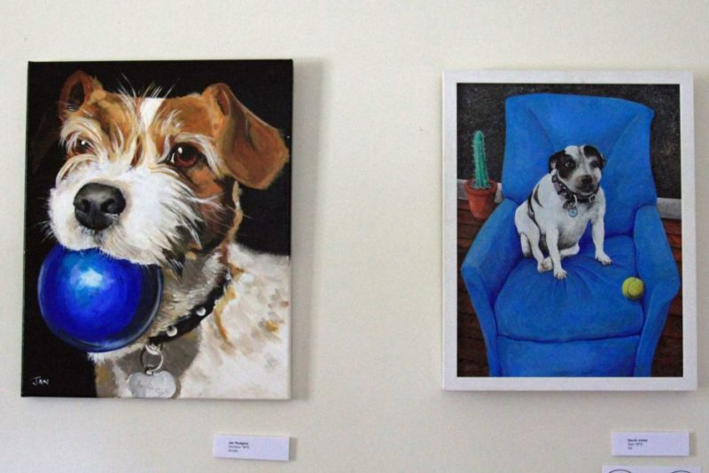 Paintings of dogs with balls in the picture