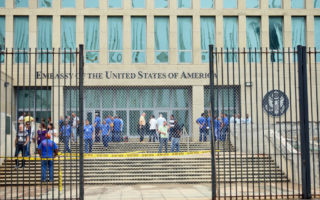 Personnel gather at the US Embassy in Havana, Cuba on September 29 as the US State Department announced it would cut staff in the wake of the mysterious sonic attacks.