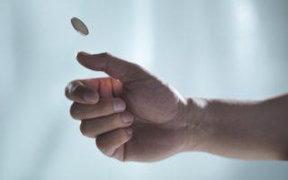 - man flipping coin, money, saving, budget.Australians lose $466 million in loose change each year.