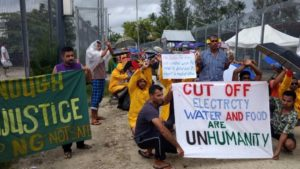 Refugees and asylum seekers at Australia's offshore processing centre at Manus Island are pictured during a peaceful protest on Monday.