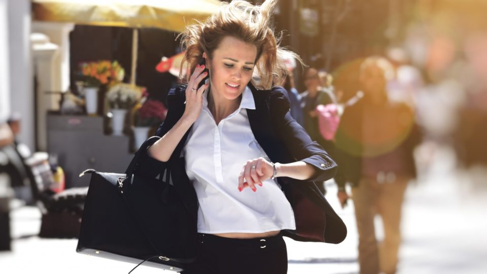 woman running down the street in a hurry