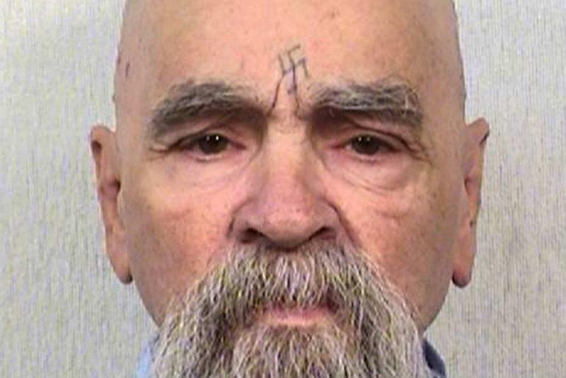 Charles Manson with swastika