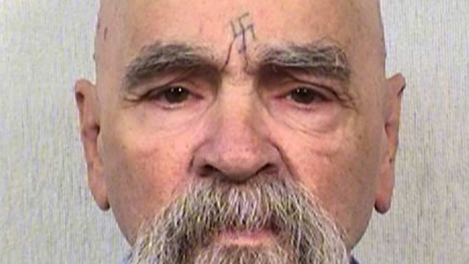 Charles Manson with swastika