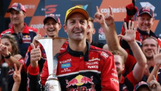 Jamie Whincup with the V8 Supercars trophy