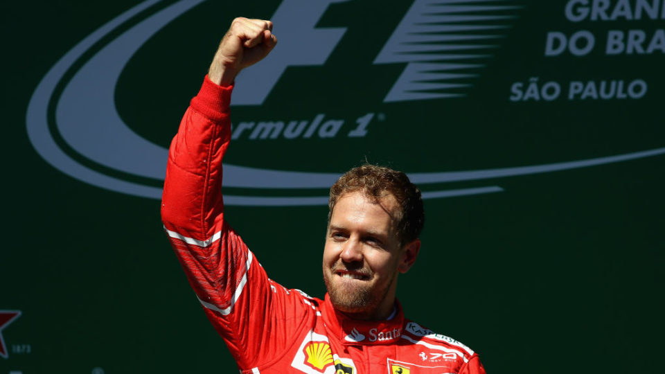 Sebastian Vettel of Germany and Ferrari celebrates celebrates his win at the Brazilian Grand Prix.