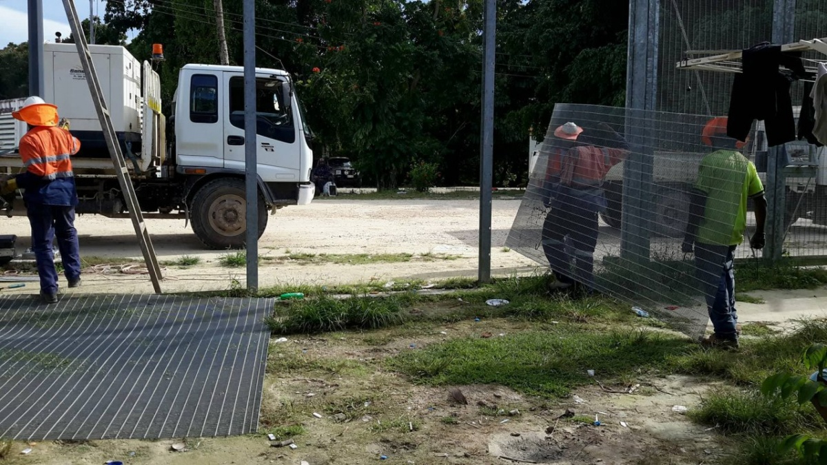 Workers could be seen dismantling fences at the site on Thursday. - Manus Island, refugees