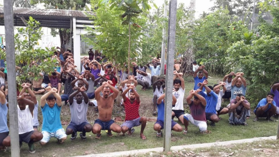 Refugees and asylum seekers are pictured protesting at the now decommissioned Manus Island detention centre.