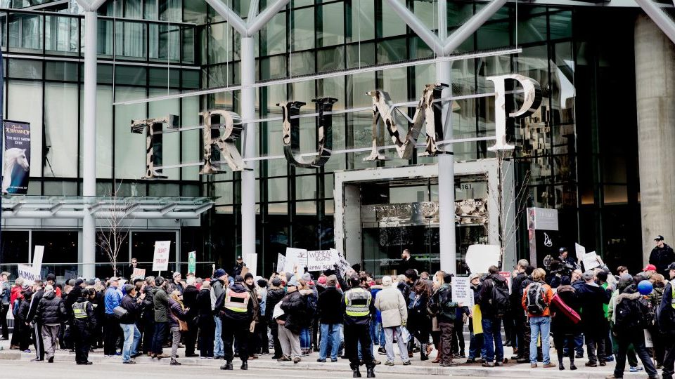 Protesters demonstrate in front of the Trump International Hotel and Tower in Vancouver during the hotel's opening day on February 28, 2017.