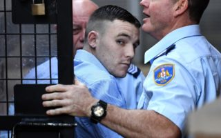 Wade Martinez is escorted into the Sydney Supreme Court in July.