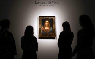 People gather around Leonardo Da Vinci's Salvator Mundi