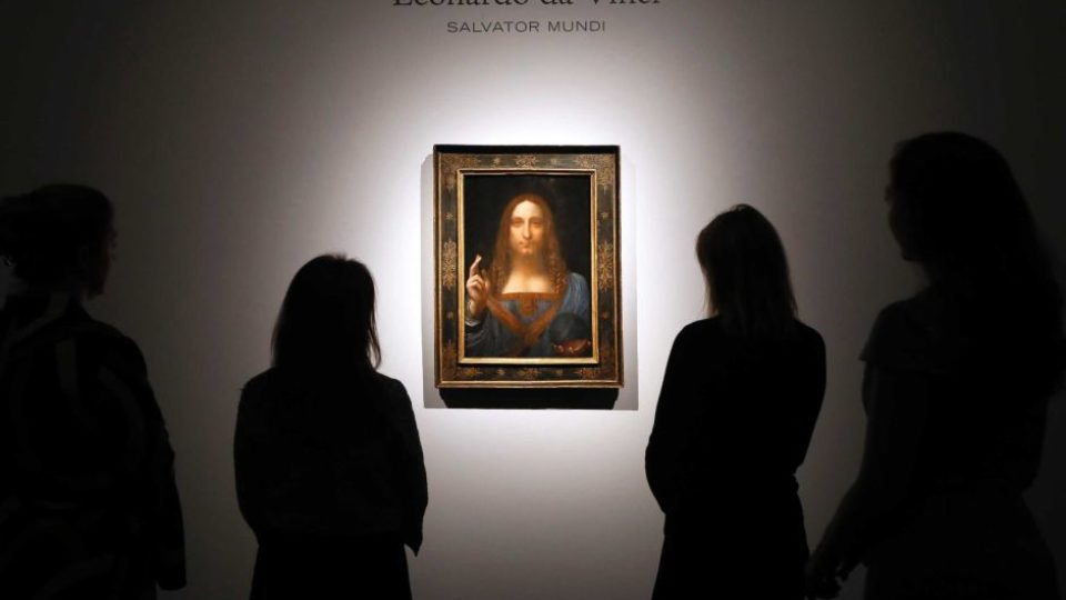 People gather around Leonardo Da Vinci's Salvator Mundi