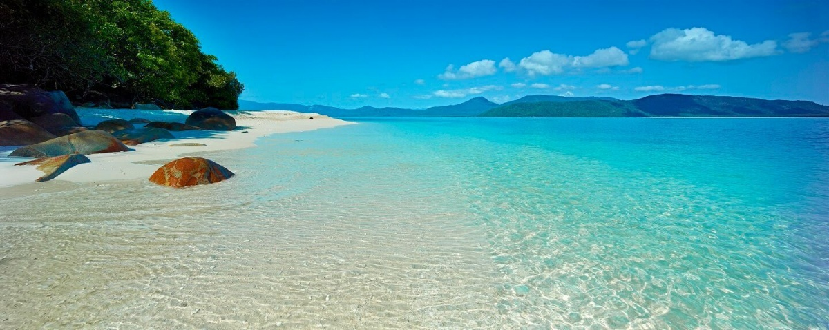 Nudey Beach is only accessible through national park, and cuddles the Great Barrier Reef.