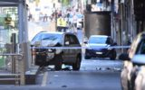A white four-wheel drive is pictured at the scene of the Flinders Street carnage in Melbourne.
