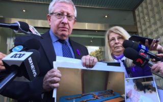 Mark and Faye Leveson with a picture of the remains of their son Matthew Leveson.