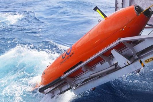 One of Ocean Infinity's eight undersea drones which will play key roles in the latest quest for the wreckage of Flight 370 slips into the water