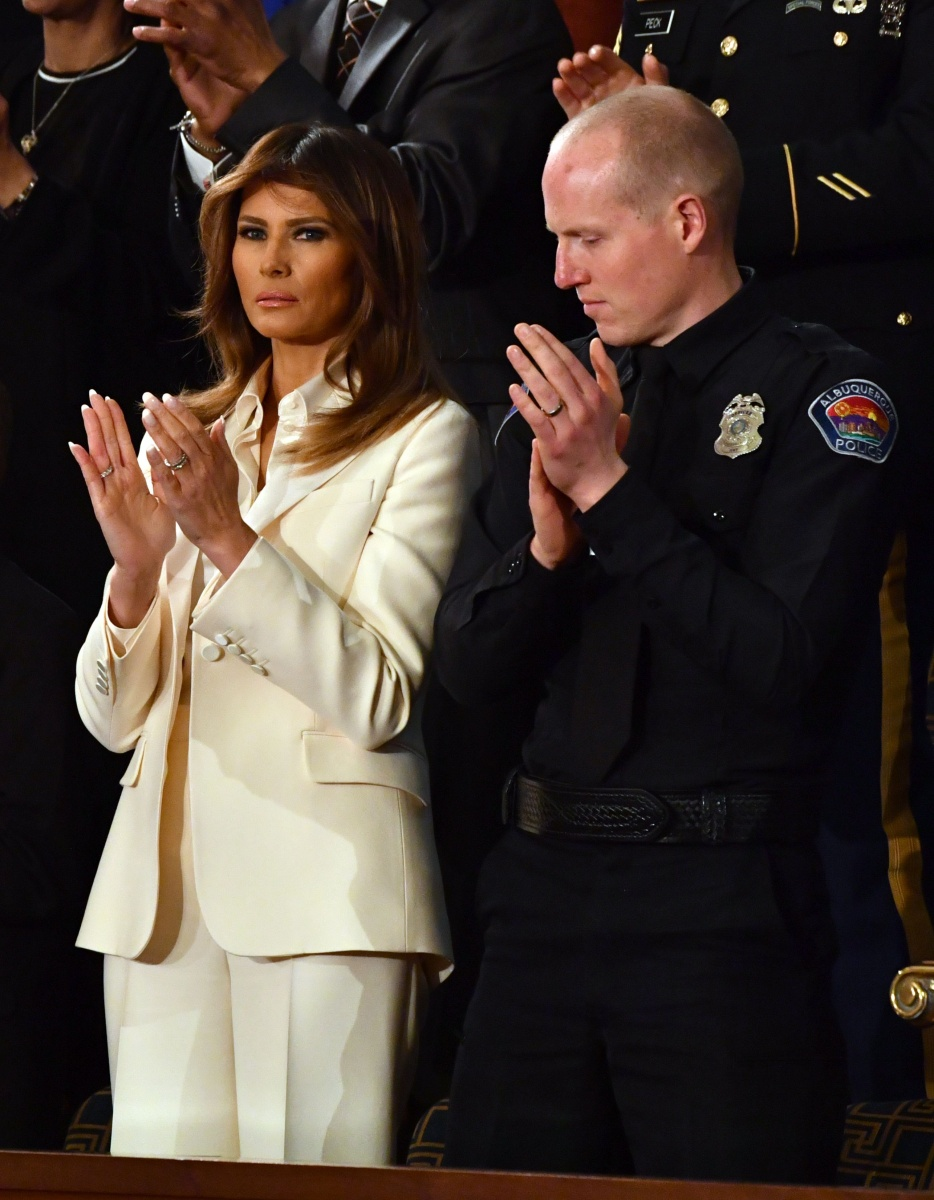 Melania Trump's first public appearance alongside her husband in weeks came with a side serving of sartorial attitude