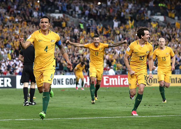 Tim Cahill celebrates with the Socceroos after scoring the second goal during the 2018 FIFA World Cup Asian Playoff match.