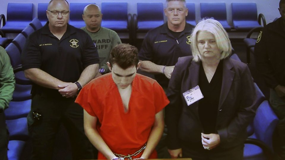 School shooting suspect remains silent in court