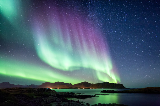 Northern Lights can be an effect of a geomagnetic solar storm. These northern lights were captured in Norway.