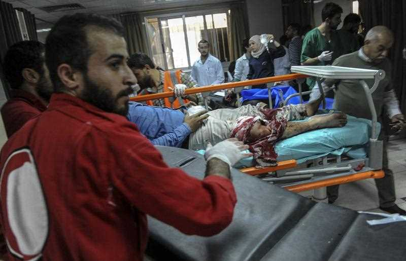 Doctors treat the wounded at Al Mouwasat Hospital in Damascus