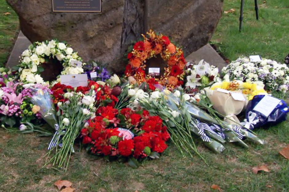 Wreaths for the nine workers killed on the job this year were laid at the memorial.