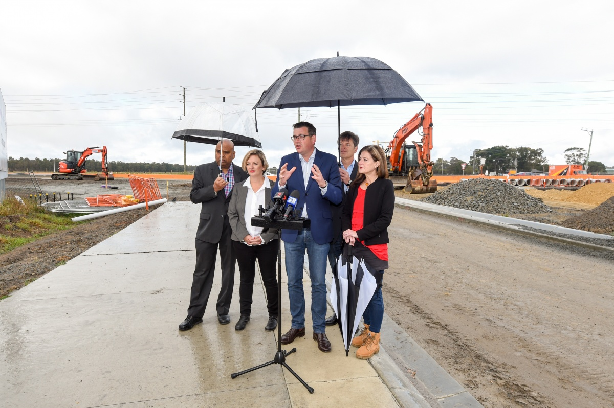 Mr Andrews is pictured promoting the $2.2 billion funding package to upgrade 13 arterial Melbourne roads on Sunday.