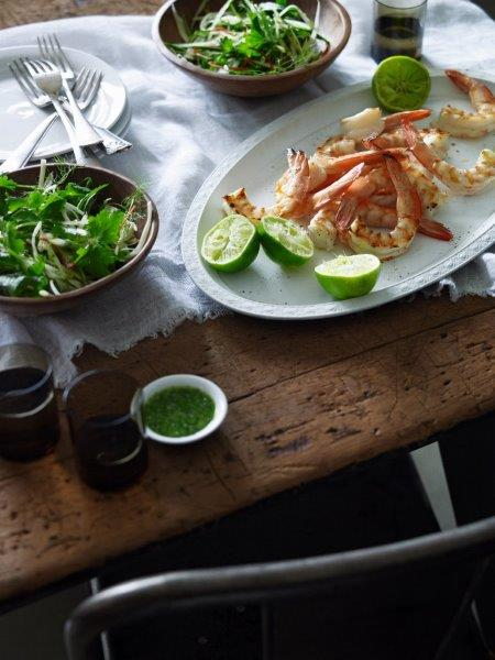 Serve by dividing salad among small bowls and serve with the prawns and lime halves to squeeze over top.