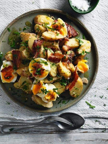 To serve, add the bacon and eggs to the potato mixture along with the herbs, toss to combine and serve at room temperature.