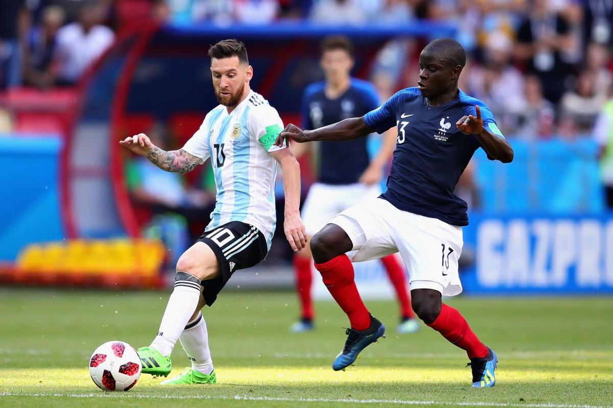 8057973853a Lionel Messi is challenged by N Golo Kante during Argentina s loss to France .