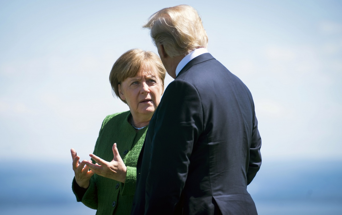 Angela Merkel talks with US President Donald Trump in Canada in June.