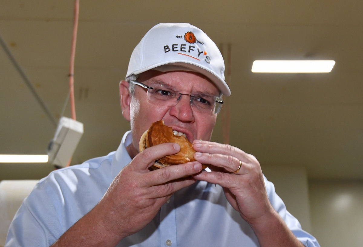 Scott Morrison eating a meat pie.