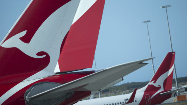 Qantas says higher fuel costs are biting.