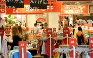 Shoppers scour an Adelaide department store in search of deals.