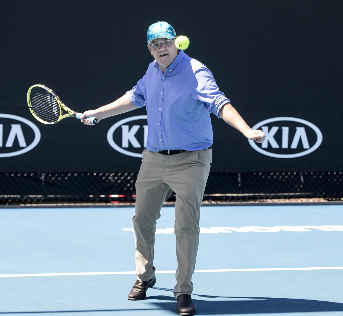 Scott Morrison plays tennis
