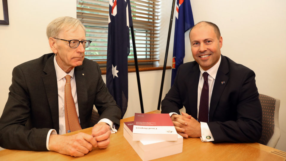Kenneth Hayne delivers the Royal Commission's final report to Treasurer Josh Frydenberg.