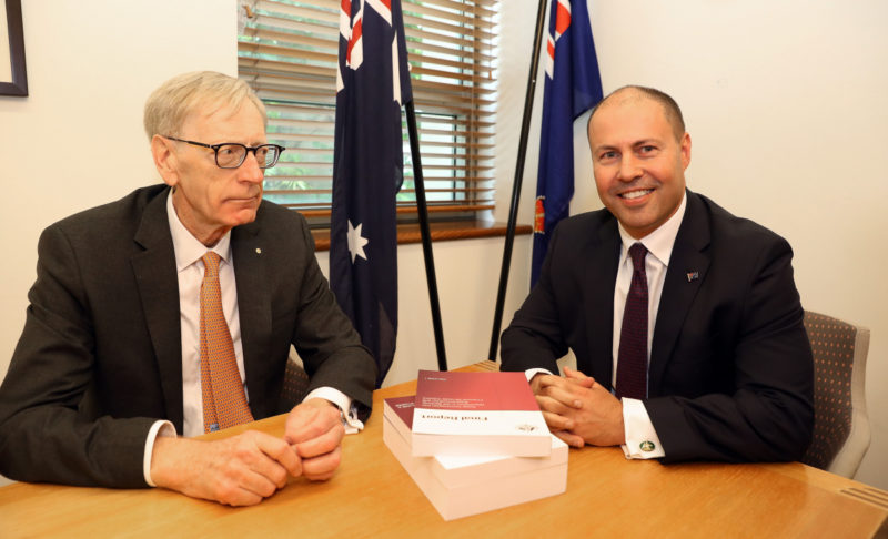 Commissioner Kenneth Hayne and Treasurer Josh Frydenberg (right) are seen with the final report from the Royal Commission into Misconduct in the Banking, Superannuation and Financial Services Industry, at Parliament House in Canberra, Friday, February 1, 2019.
