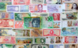 An Australian $100 note sits alongside currencies from around the world.