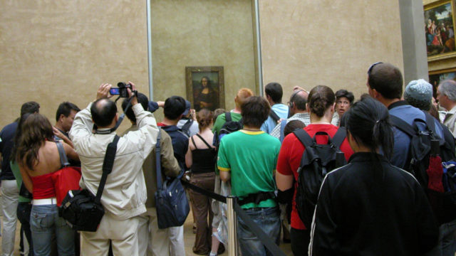 Somewhere, beyond that crowd, is one of the world's most famous paintings.